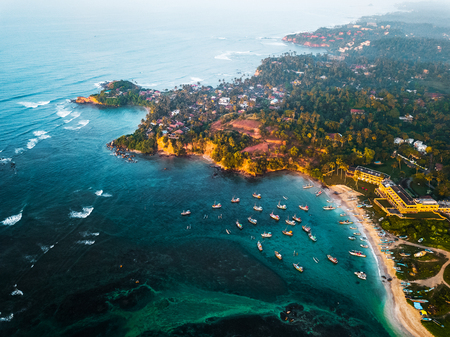 Aerial view of the Weligama cape with fisherman village and anchored boats