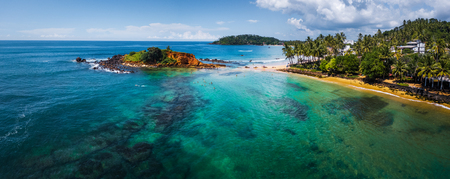 Aerial panorama of the tropical beach and clear sea with coral reefs in the town of Mirissa, Sri Lanka Reklamní fotografie - 92153824