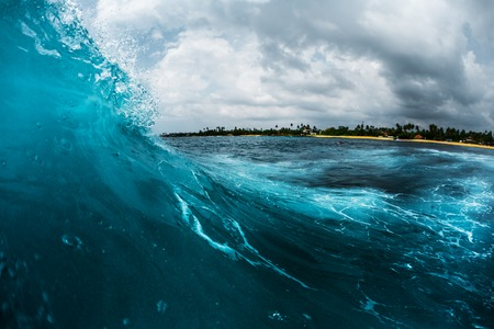Ocean wave breaking on reef shore. Surfing point break spot named Lazy Lefts, Midigama, Sri Lanka