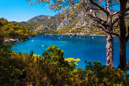 Oludeniz beach and blue clear water of Blue Lagoon in Aegean sea, Turkey Stock Photo