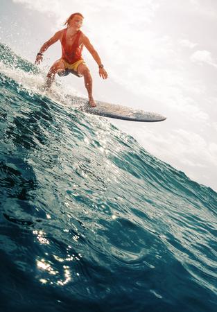 Surfer rides the ocean wave Stock fotó