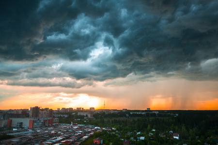 View of the buildings in the city of Izhevsk at sunset with dramatic sky Stock Photo