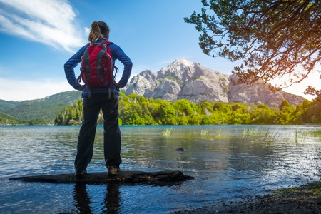 Woman hiker enjoys view of the lake and mountains. Bariloche, Argentina
