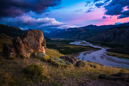 Valley with river and mountains during sunrise. Patagonia, Argentina 写真素材