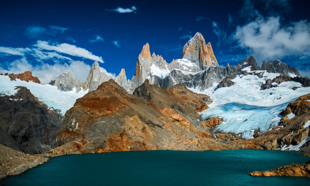 Mountain of Fitz Roy during sunny day with some clouds in the sky. Argentina