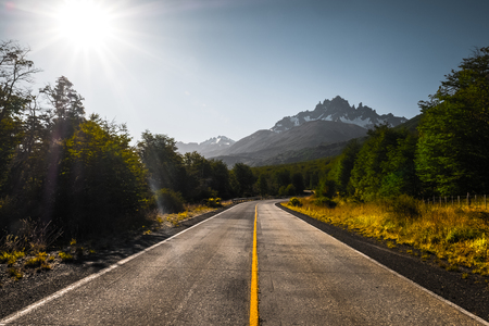 Asphalt road and mountains. Carretera Austral road near the Cerro Castillo mountain (Cerro Castillo peak is on the background). Chile