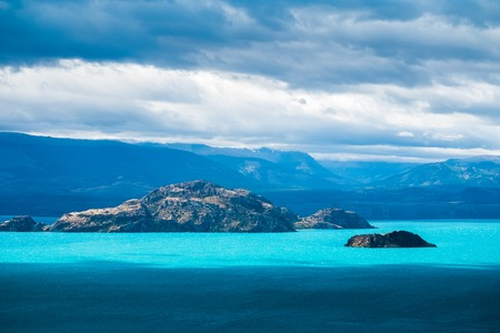 Islets in the middle of the lake with turquoise water. Lago General Carrera, Chile 写真素材