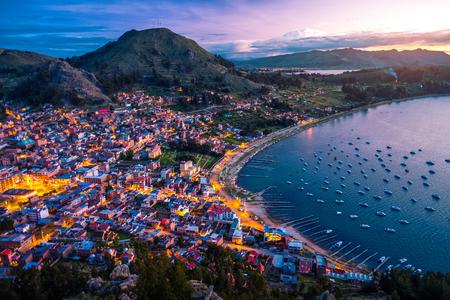 Town of Copacabana and lake of Titicaca during sunset. Bolivia Standard-Bild