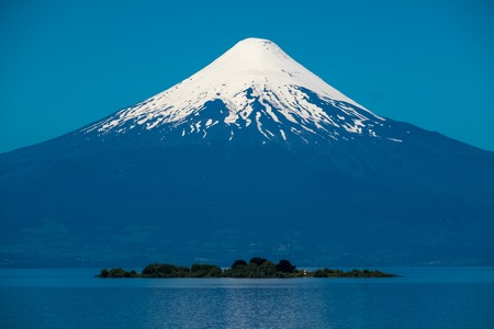 Volcano of Osorno and the island on the lake. Chile
