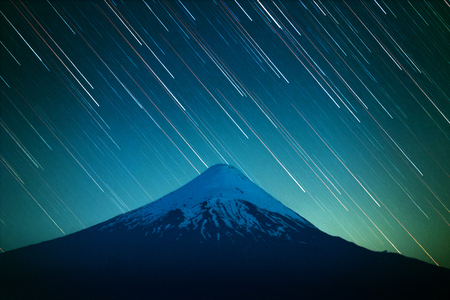 Volcano of Osorno and night sky with star trails. Patagonia, Chile