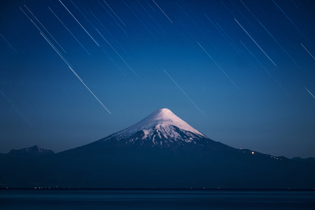 Volcano of Osorno and starry sky with trails. Chile