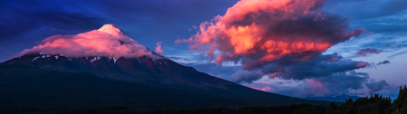 Panorama of the volcano of Osorno during sunset with big cloud, Chile