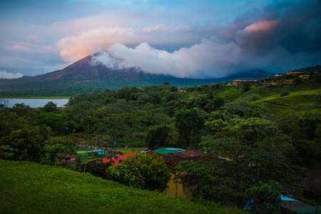 Volcano of Arenal covered with clouds during sunset. Costa Rica