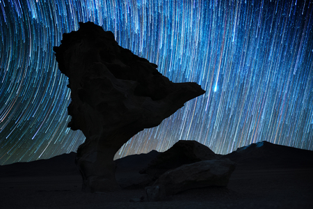 Rock formation named Arbol de Piedra at night with starry sky on the background. Bolivia Banco de Imagens