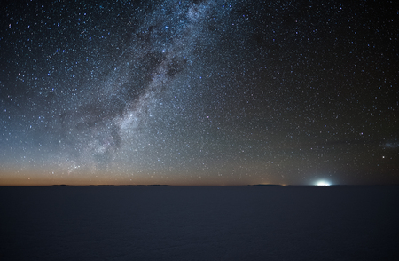 Night starry sky over the salt flat of Salar de Uyuni, Altiplano, Bolivia