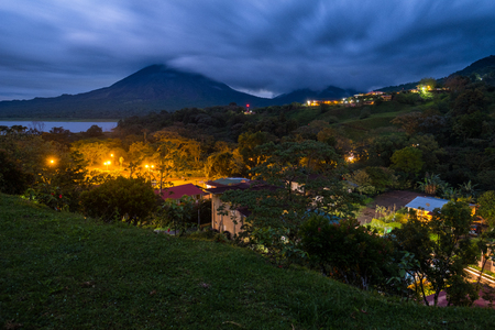 Village with highlighted buildings and tropical gardens near the volcano of Arenal, Costa Rica