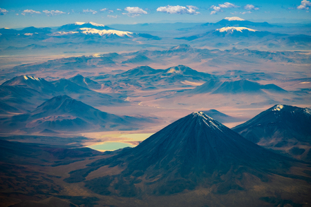 Volcano of Licancabur and the valley with mountains of Eduardo Avaroa National Reserve, Bolivia Stock Photo