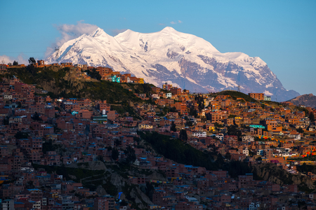 City of La Paz and mountain of Illimani (Aymara) on the background, Bolivia Stock Photo