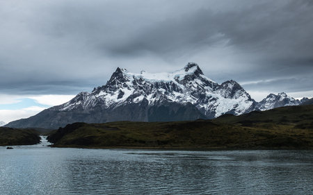 Mountains of Torres del Paine National Park with lake of Pehoe on the foreground at rainy day, Chile 写真素材