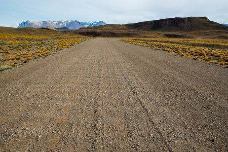 Gravel empty unnamed road in Patagonia. Chile