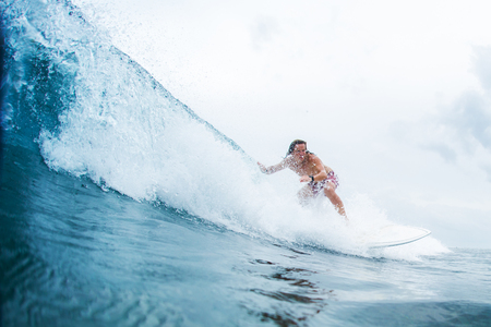Surfer rides the ocean wave in tropics Stock Photo