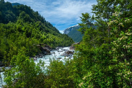 Green valley of Quelat National Park, with hanging glacier visible on the horizon, Puyuhuapi, Patagonia, Chile