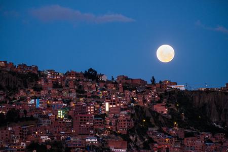 City of La Paz at twilight with full moon on the sky, Bolivia