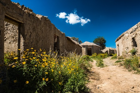 Abandoned houses made from simple materials in the old part of the village of Poopo, Bolivia