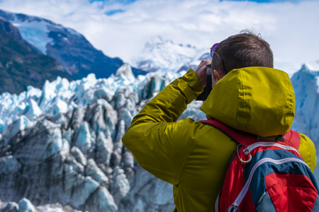 Photographer taking a picture of the ice of glacier. Perito Moreno Glacier, Los Glaciares National Park, Argentina
