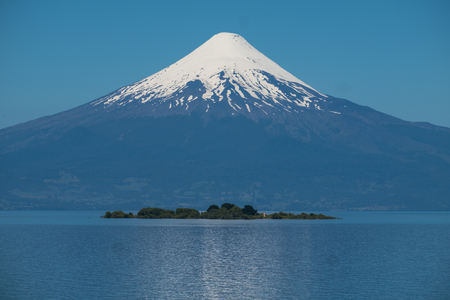 Volcano of Osorno and lake of Llanquihue with islet. Chile 写真素材