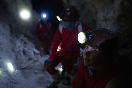 Tourists have a rest inside the cooperative mine located in the mountain of Cerro Rico near the city of Potosi, Bolivia. Banco de Imagens - 102624195