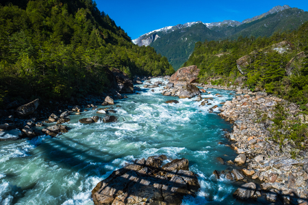 Rapid river in Patagonian mountains, valley of the Quelat National Park, Chile 写真素材