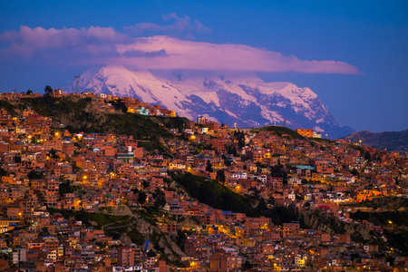 City of La Paz and mountain of Illimani during sunset. Bolivia