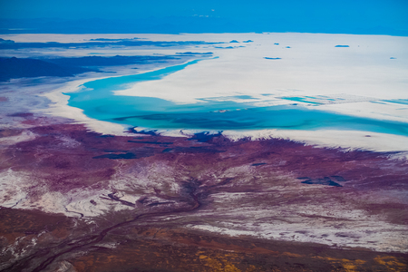 Aerial view of the Salar de Uyuni and its coast, Bolivia. Southern edge of salt flats partly covered with water.