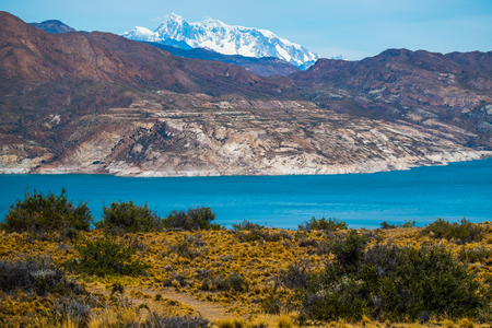 Blue lake and mountains with snow. Patagonia, Argentina