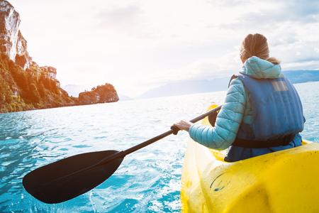 Woman paddles kayak on the lake of General Carrera, Patagonia, Chile Stock Photo