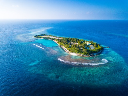 Aerial view of the tropical island in the middle of the Indian Ocean. Maldives Фото со стока