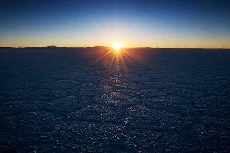 Salar de Uyuni at sunrise. Salt flat of the Salar de Uyuni during sunrise, Bolivia