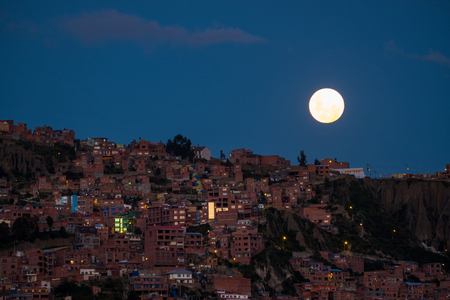 Moon rises over the city of La Paz, Bolivia