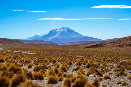 Mountain and lenticular clouds at a desert in south of Bolivia Фото со стока - 104878151