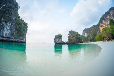 Beach and calm sea on the tropical island of Hong at early morning, Thailand
