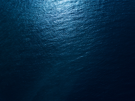 Sea surface aerial view. Dark and contrast version 版權商用圖片