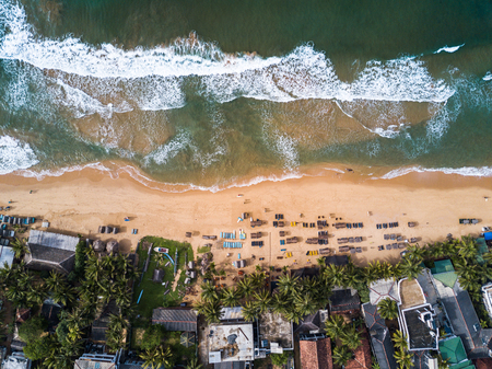 Aerial view of the tropical beach in the town of Hikkaduwa, Sri Lanka