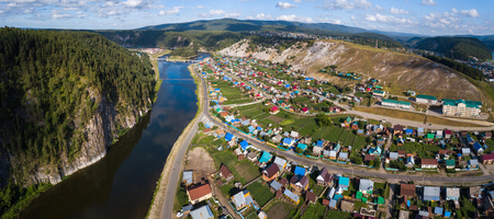 Aerial panorama of the village of Starosubkhangulovo and the river of Belaya, Ural Mountains, Russia 스톡 콘텐츠
