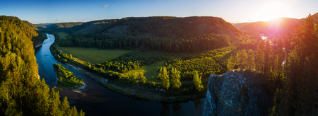 Aerial panorama of the Ural Mountains and the river of Belaya during sunrise. Russia