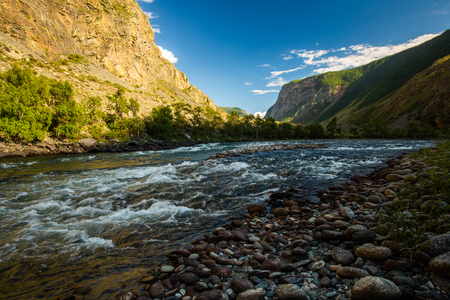 Rapid river of Chulyshman during sunset. Altai Republic, Russia