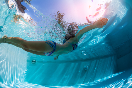 Young woman swims in the pool Stock Photo
