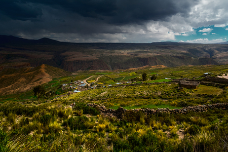 Rural Bolivian landscape with rainy clouds Stock Photo
