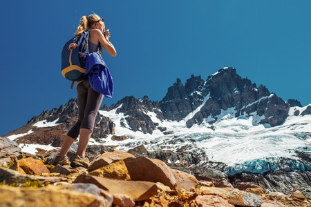 Amateur photographer and hiker takes picture of the mountain with glacier. Cerro Castillo Mountain, Chile Stock Photo
