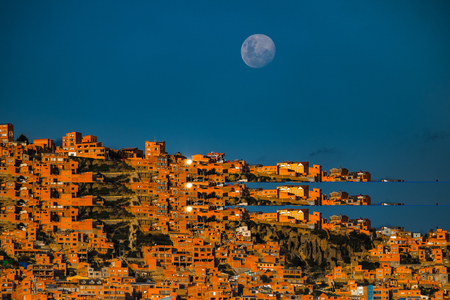 Blue moon rises over the city of La Paz, Bolivia